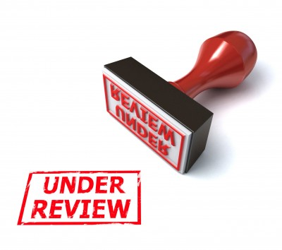 Stamp that says under review