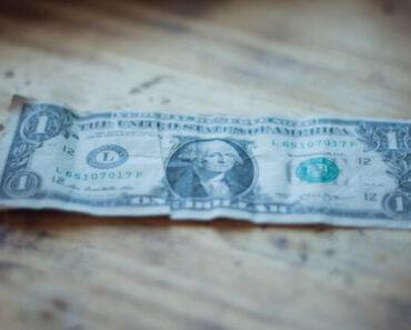 weak dollar, crumpled dollar on table