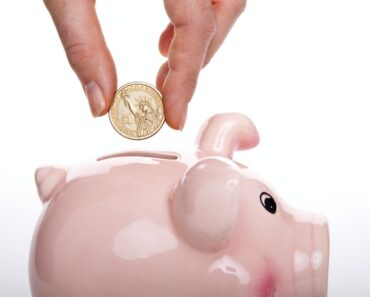 cost cutting strategy multifamily property management putting coin into piggy bank