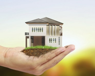 professional property management, real estate without ownership, person holding small house in hand